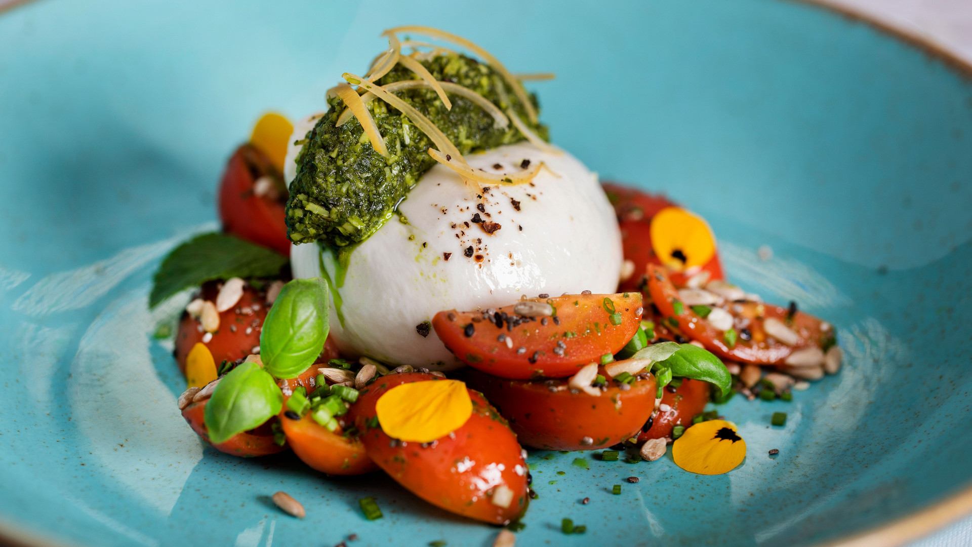 Buratta, mixed tomatoes, sunflower and chia seed salad