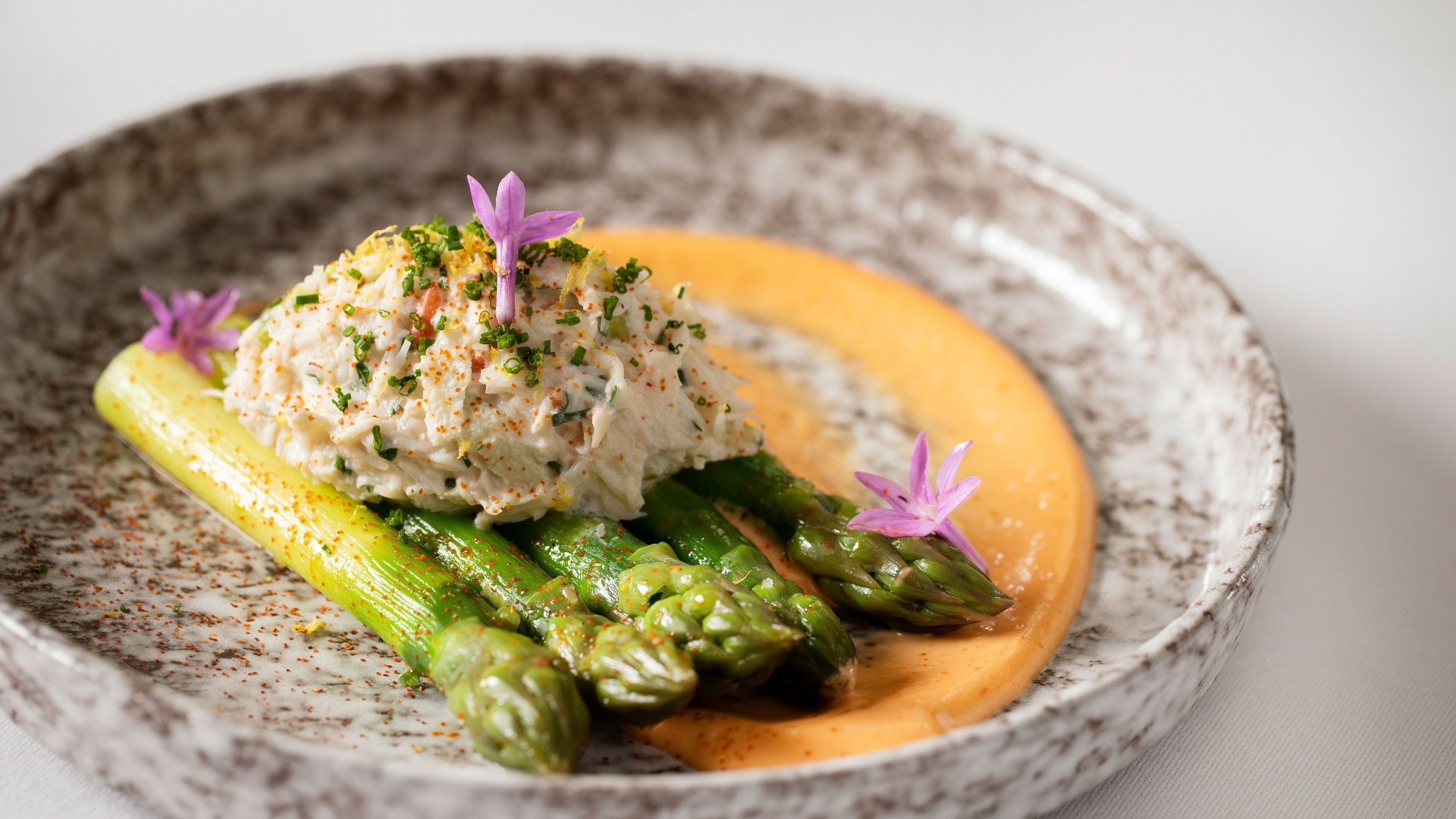 Crab and gold rush apple salad, green asparagus and mimosa dressing