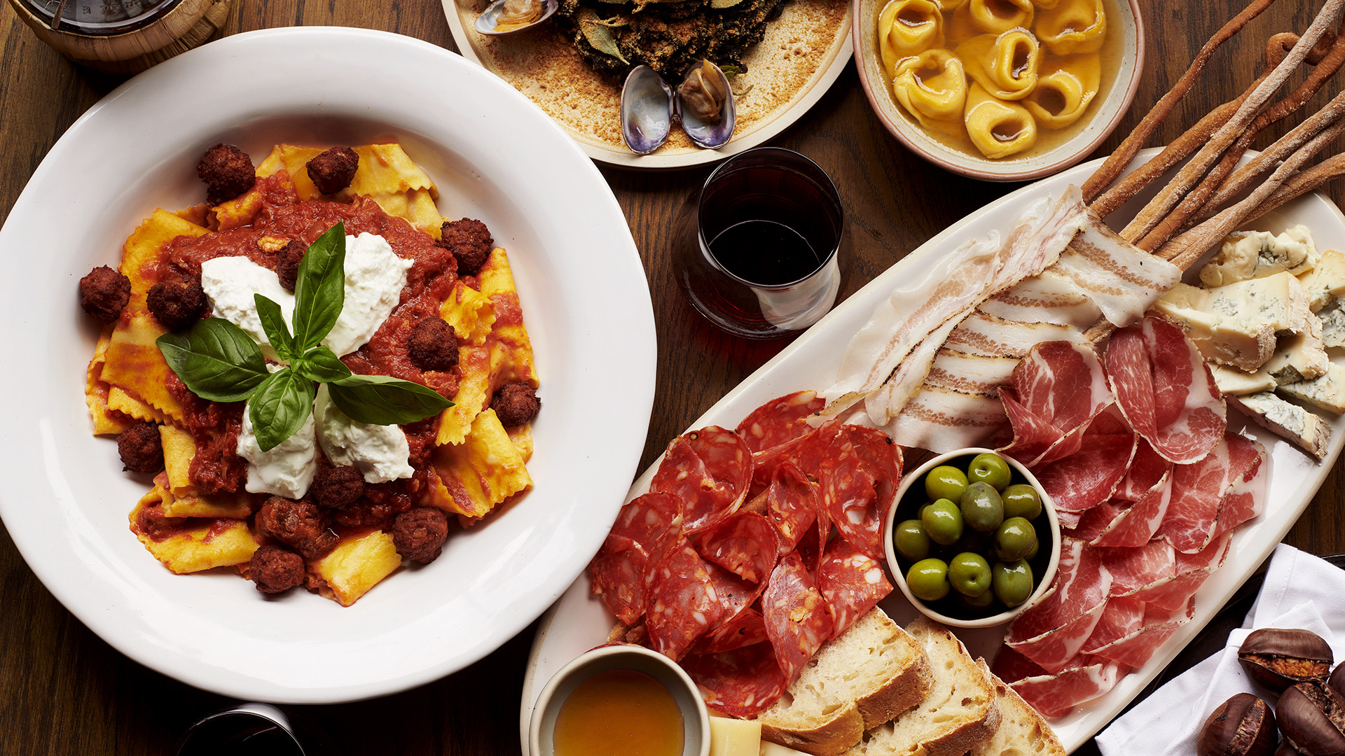 A spread of dishes at Officina 00