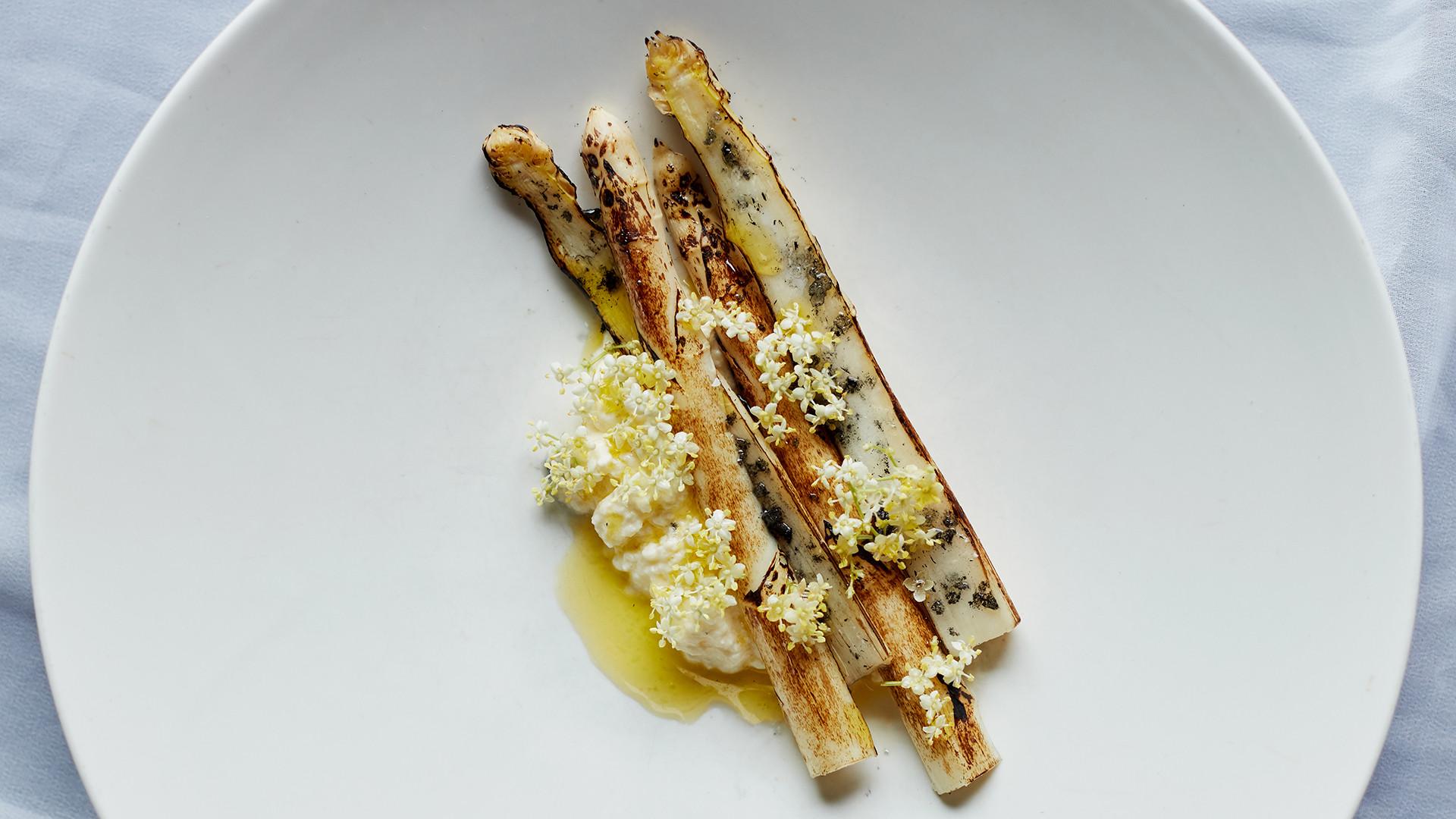 BBQ white asparagus, fresh goat's curd and elderflower oil