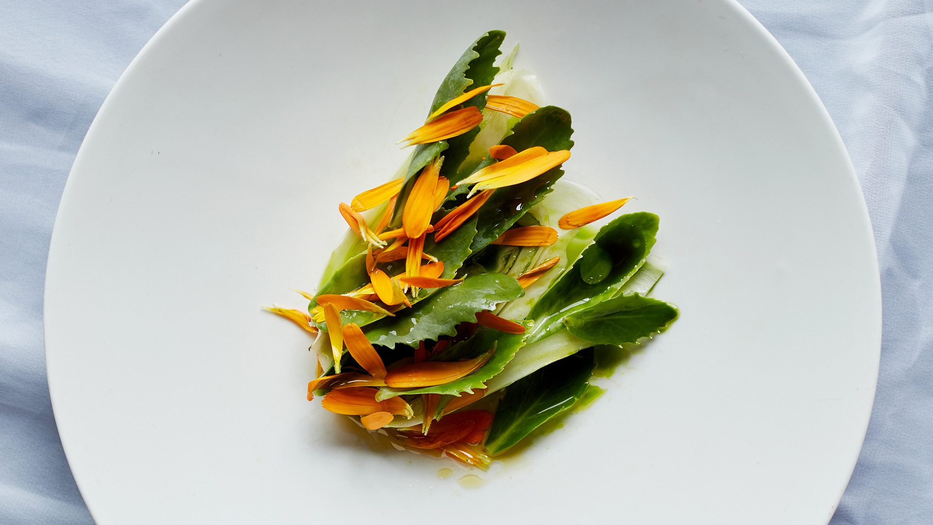 Fennel cooked in aged beef fat, orpin dressed in marigold vinegar and fresh marigold at Silo