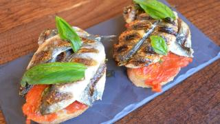 Ember Yard's grilled sardines on toast with tomato and fresh basil