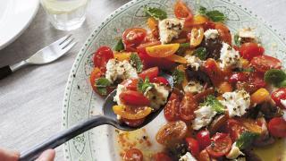Anna Jones' traffic light tomatoes with lemon-roasted feta
