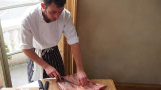 One of the Cubitt House collection's chefs expertly preparing a meal