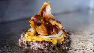 Bleecker Burger's signature cheese and bacon burger