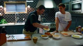 Antoni showing Jeremy how to grill hot dogs in season one episode eight