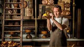 Calum Franklin holding one of his creations in the Holborn Dining Room Pie Room