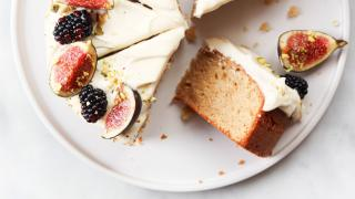 A beautiful bake covered in vanilla frosting, blackberries and fresh figs