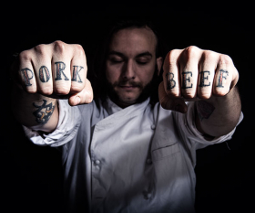 Leon Borja's tattooed knuckles closeup