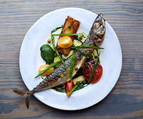 This one's for sharing, whole mackerel with potato cake and confit tomatoes