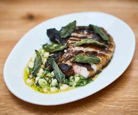 Orasay's Tamworth chop with white butter beans and spring greens
