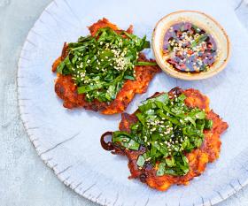 Make Meera Sodha's kimchi pancakes with spinach salad; photography by David Loftus