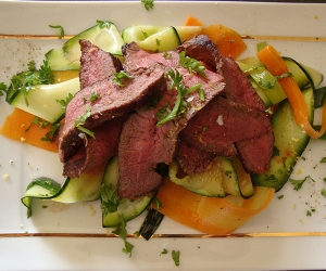 Venison steak with vegetable ribbons