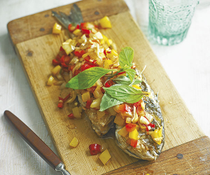 Fried sea bream with peppers and chillis