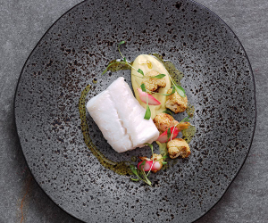 Michel Roux Jr's poached Skrei, cauliflower purée and pickled radishes