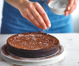 Alexandra Dudley's sea salt chocolate torte dusted with cocoa powder; Photograph by Andrew Burton