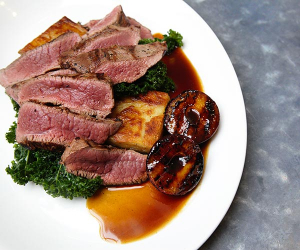 chef Cameron Emirali's plum venison with layered potato and kale; photography by Ella Singleton