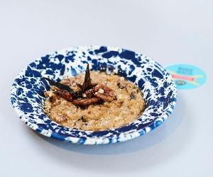 Foodism's salted caramel milk stout porridge with maple-candied bacon and pecans