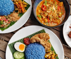 Blue pea flower herb rice with skate curry from Malaysian Nyonya Supper Club; photograph by Guan Chua
