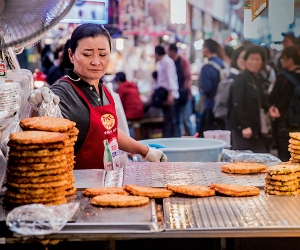 Things to do in Seoul, South Korea: A street-food trader cooks pajeon, spring onion pancakes