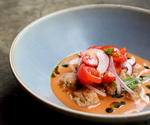 Panzanella, tomato soup, lovage oil at Mazzo